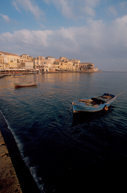 Crete, Greece, Chania, Khania (Greek sp), Inner harbor seawall and old town, Mediterranean Sea,