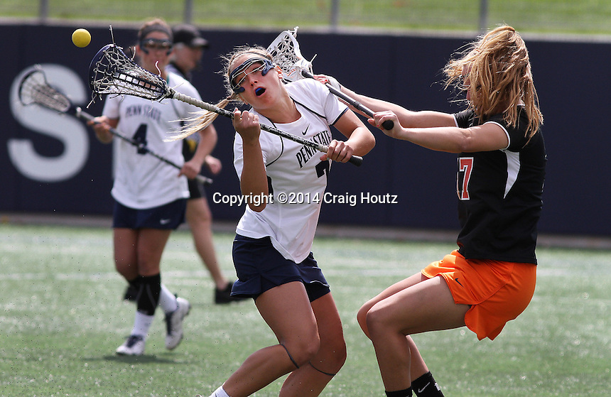 Penn State's Tatum Coffey (7) collides with Princeton's Liz Bannantine (17) on April 26, 2014.  No. 12 Penn State defeated No. 19 Princeton 13-12. Photo/© 2104 Craig Houtz