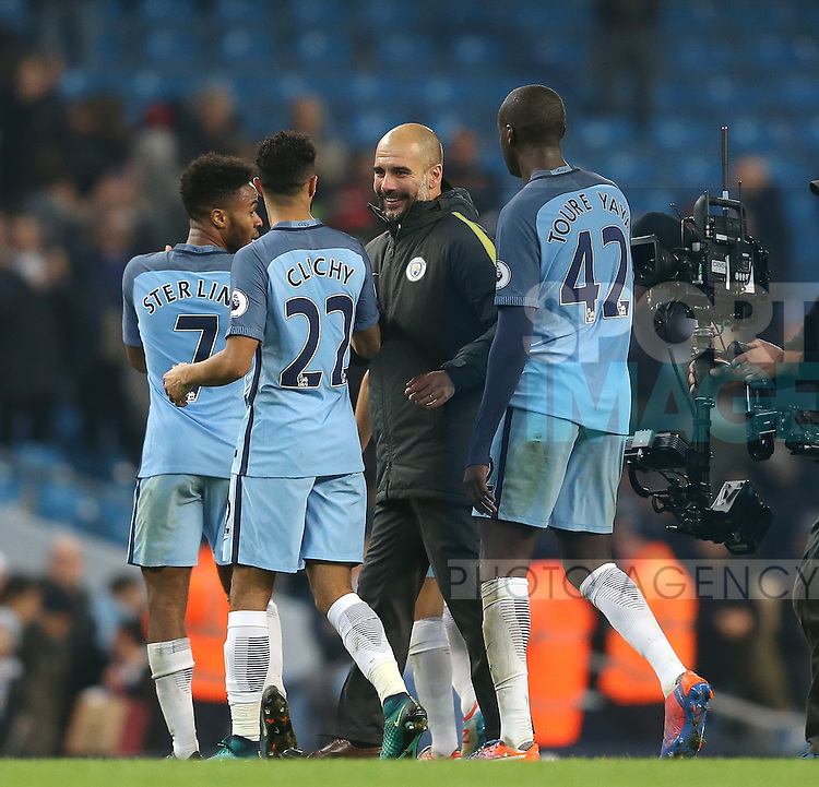Josep Guardiola manager of Manchester City greets his players during the English Premier League match at the Etihad Stadium, Manchester. Picture date: December 18th, 2016. Picture credit should read: Simon Bellis/Sportimage