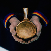 A Sami man holding hand made bowl, Lapland, Sweden