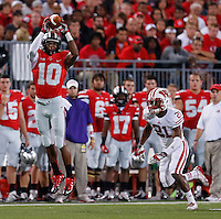 Ohio State Buckeyes wide receiver Philly Brown (10) catches a pass while defended by Wisconsin Badgers cornerback Peniel Jean (21) during Saturday's NCAA Division I football game at Ohio Stadium in Columbus on September 28, 2013. (Barbara J. Perenic/Columbus Dispatch)