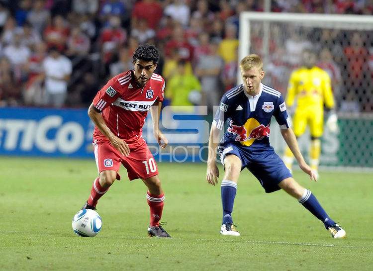 Chicago forward Nery Castillo (10) controls the ball in front of New York defender Tim Ream (5).  The Chicago Fire tied the New York Red Bulls 0-0 at Toyota Park in Bridgeview, IL on August 8, 2010