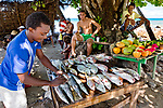 Seychelles, Mahé island, Tropics, Indian ocean, Man selling Fish on Beau Vallon Beach, Baie Beau Vallon