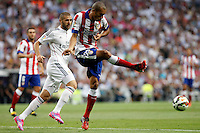 Benzema of Real Madrid and Miranda of Atletico de Madrid during La Liga match between Real Madrid and Atletico de Madrid at Santiago Bernabeu stadium in Madrid, Spain. September 13, 2014. (ALTERPHOTOS/Caro Marin)
