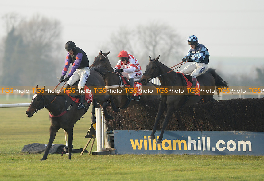 Champion Court ridden byIan Popham leads at the last from race winner Riverside Theatre ridden by Barry Garaghty and Captain Chris with Richard Johnson  at Huntingdon Racecourse, Brampton, Cambridgeshire - 12/12/2013 - MANDATORY CREDIT: Martin Dalton/TGSPHOTO - Self billing applies where appropriate - 0845 094 6026 - contact@tgsphoto.co.uk - NO UNPAID USE