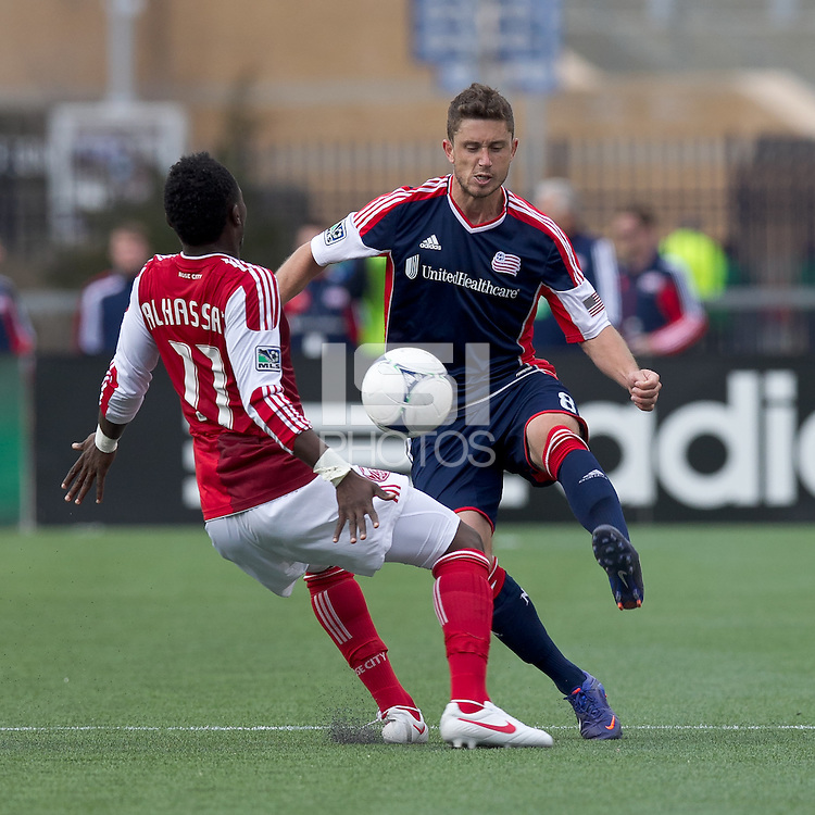 New England Revolution midfielder/defender Chris Tierney (8) controls ball and avoids Portland Timber player. In a Major League Soccer (MLS) match, the New England Revolution defeated Portland Timbers, 1-0, at Gillette Stadium on March 24, 2012