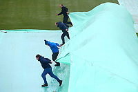 Ground staff start to clear the covers during Yorkshire CCC vs Essex CCC, Specsavers County Championship Division 1 Cricket at Emerald Headingley Cricket Ground on 13th April 2018