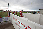 Prestatyn Town 0 Port Talbot Town 0, 19/10/2013. Bastion Gardens, Welsh Premier League. The home players leaving the pitch at Bastion Gardens at the conclusion of the match between Prestatyn Town and visitors Port Talbot Town in the Welsh Premier League. Prestatyn Town were Welsh Cup winners in 2013. The match ended goalless and was watched by 211 spectators. Photo by Colin McPherson.