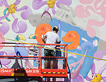 Sebastian Coolidge paints during the Mural Marathon on Sunday July 1, 2018 in downtown Reno.