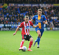 Lincoln City's Joe Morrell crosses under pressure from Shrewsbury Town's David Edwards<br /> <br /> Photographer Andrew Vaughan/CameraSport<br /> <br /> The EFL Sky Bet League One - Shrewsbury Town v Lincoln City - Saturday 11th January 2020 - New Meadow - Shrewsbury<br /> <br /> World Copyright © 2020 CameraSport. All rights reserved. 43 Linden Ave. Countesthorpe. Leicester. England. LE8 5PG - Tel: +44 (0) 116 277 4147 - admin@camerasport.com - www.camerasport.com