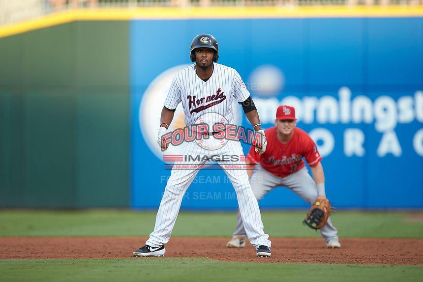 Alcides Escobar (2) of the Charlotte Hornets takes his lead off of first base against the Louisville Bats at BB&T BallPark on June 22, 2019 in Charlotte, North Carolina. The Hornets defeated the Bats 7-6. (Brian Westerholt/Four Seam Images)