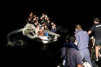 Lampedusa,2011. Uomini della Capitaneria di Porto impegnati nelle operazioni di ricerca e salvataggio di immigrati.<br /> Rescue operation of Italian Coast Guard off Lampedusa.
