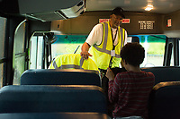 Johnny Crudup (CQ), a full-time substitute bus driver for Wake County talks to a student as he is dropped off at East Garner Elementary school in Garner, NC on Friday, March 31, 2017. (Justin Cook for The Wall Street Journal)<br /> <br /> BUSES Summary<br /> A shortage of school bus drivers is forcing one of North Carolina&rsquo;s largest school districts to consider starting class as early as 7:10 a.m. and as late as 9:15 a.m. this fall, to give the limited number of drivers time to do three or more runs each morning.