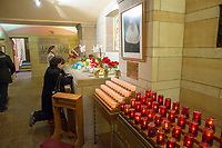 One of the last visitors, Colleen Mooney-Coughlin of Bensalem, Pennsylvania prays at the tomb of St. Katharine Drexel at the National Shrine of St. Katharine Drexel Saturday, December 30, 2017 in Bensalem, Pennsylvania. Drexel was an American heiress who dedicating herself to work among the American Indians and African-Americans in the western and southwestern United States. She was canonized a saint by the Roman Catholic Church in 2000. (Photo by William Thomas Cain/Cain Images)