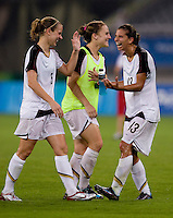 USWNT midfielder (5) Lindsay Tarpley enjoys the win with teammate (13) Tobin Heath after playing at Shanghai Stadium.  The US defeated Canada, 2-1, in extra time and advanced to the semifinals during the 2008 Beijing Olympics in Shanghai, China.