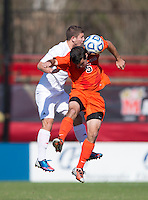 Alex Martinez (15) of North Carolina State goes up for a header with Ben Strong (5) of Virginia Tech during the game at Ludwig Field in College Park, MD. Virginia Tech defeated North Carolina State, 3-2, in the ACC tournament play-in game.