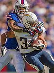 21 September 2014: San Diego Chargers running back Donald Brown is tackled by Buffalo Bills cornerback Stephon Gilmore at Ralph Wilson Stadium in Orchard Park, NY. The Chargers defeated the Bills 22-10 in AFC play. Mandatory Credit: Ed Wolfstein Photo *** RAW (NEF) Image File Available ***