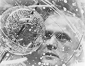 Astronaut John H. Glenn Jr. looks into a Celestial Training Device (globe) during training in the Aeromedical Laboratory at Cape Canaveral, Florida in February, 1962..Credit: NASA via CNP