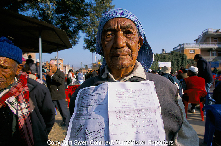 Ex-Servicemen with a photocopy of his release document from the British army, during a GAESO meeting in Kathmandu Nepal..After serving 7 years, 2 months and 6 days for the British Gorkha army and fighting during the World War II, this ex-Servicemen have been thanks without any financial compensation or any pension..-The full text reportage is available on request in Word format