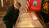 Washington, D.C. - January 16, 2006 -- United States President George W. Bush looks at the Emancipation Proclamation at the National Archives in Washington, DC on January 16, 2006. The man in background is Allen Weinstein, the archivist of the United States.  <br /> Credit: Dennis Brack - Pool via CNP