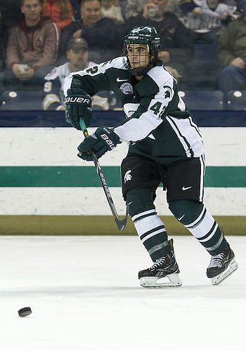 December 07, 2012:  Michigan State defenseman Jake Chelios (#42) passes the puck during NCAA Hockey game action between the Notre Dame Fighting Irish and the Michigan State Spartans at Compton Family Ice Arena in South Bend, Indiana.  Notre Dame defeated Michigan State 3-2.