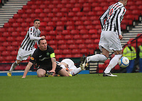 Scott Brown on the ground tackled by Jim Goodwin in the St Mirren v Celtic Scottish Communities League Cup Semi Final match played at Hampden Park, Glasgow on 27.1.13.