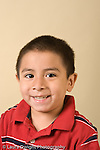 portrait headshot of preschool boy age 4 or 5 vertical