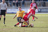 Mark Byrne of Newport County fouls Billy Kee of Accrington Stanley during the Sky Bet League 2 match between Newport County and Accrington Stanley at Rodney Parade, Newport, Wales on 28 March 2016. Photo by Mark  Hawkins.