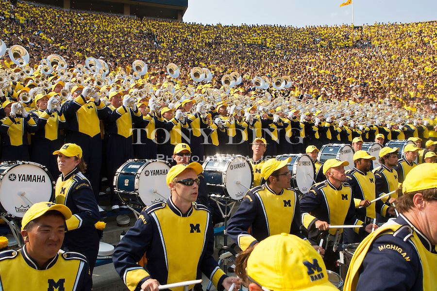 The Michigan Marching Band has prime seating right at the front of Michigan Stadium's student section, during the season opener against Western Michigan, Saturday, Sept. 3, 2011 in Ann Arbor, Mich. (Tony Ding for The New York Times)