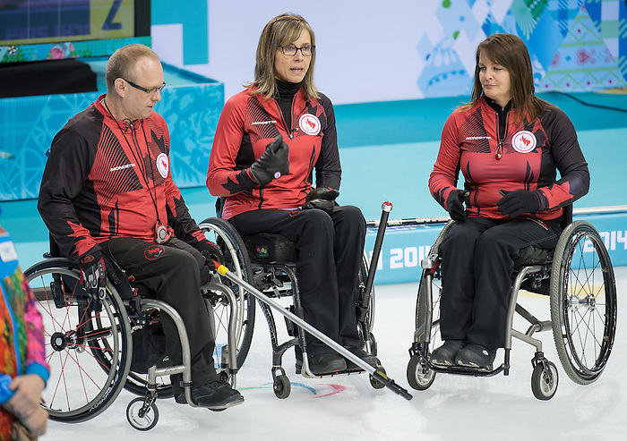Sochi, RUSSIA - Mar 15 2014 - Sonja Gaudet, Ina Forrest and Dennis Thiessen as Canada takes on China in the semi finals of Wheelchair Curling  at the 2014 Paralympic Winter Games in Sochi, Russia.  (Photo: Matthew Murnaghan/Canadian Paralympic Committee)