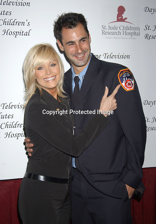 ..Catherine Hickland and a fireman ..at the Ninth Annual Daytime Television salutes St. Jude Children's Research Hospital benefit in New York City on ..October 10, 2003  at the Marriott Marquis Hotel. ..Photo by Robin Platzer, Twin Images