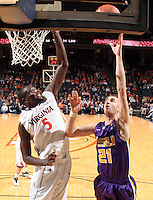 Jan. 2, 2011; Charlottesville, VA, USA; Virginia Cavaliers center Assane Sene (5) prepares to block the shot of LSU Tigers forward Matt Derenbecker (21) during the game at the John Paul Jones Arena. Virginia won 64-50. Mandatory Credit: Andrew Shurtleff-