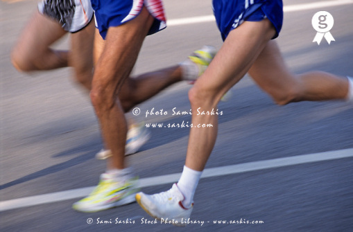 Three runners, low section (blurred motion) (Licence this image exclusively with Getty: http://www.gettyimages.com/detail/sb10066226ad-001 )