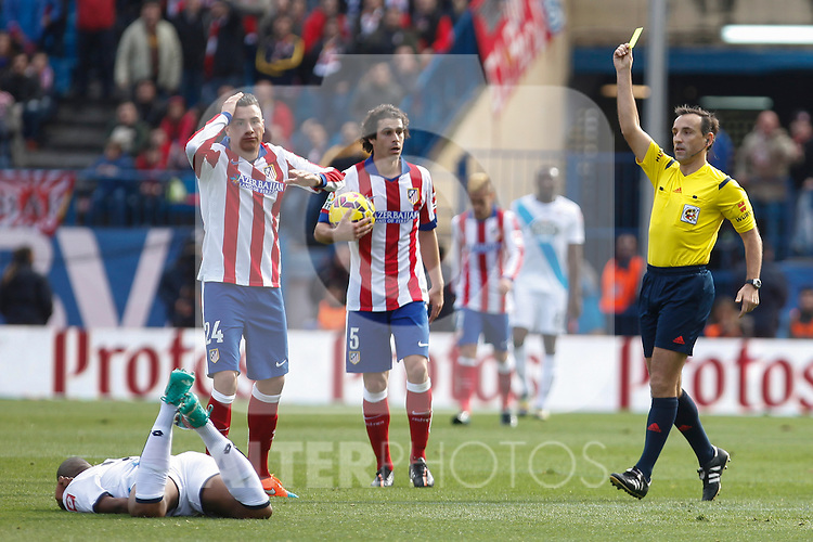 Atletico de Madrid´s Gimenez receives a yellow card during 2014-15 La Liga match between Atletico de Madrid and Deportivo de la Coruña at Vicente Calderon stadium in Madrid, Spain. November 30, 2014. (ALTERPHOTOS/Victor Blanco)