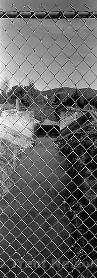 View of San Ramon Creek. through chain-link fence<br />
