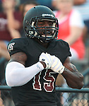 Lindenwood-Belleville WR Harvey Binford (15) from East St. Louis celebrates in the end zone after snagging a pass and running the ball in for a touchdown in the first quarter.