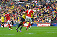 Sam Winnall of Barnsley scores the equaliser with a header past goalkeeper Benjamin Buchel of Oxford United  to make it 1-1 during the Johnstone's Paint Trophy Final match between Oxford United and Barnsley at Wembley Stadium, London, England on 3 April 2016. Photo by Alan  Stanford / PRiME Media Images.