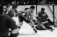Seals vs Detroit Redwings, Seals #6 Dick Mattiussi tries to score against Wings goalie Joe Daley, #15 Al Karlander. (1971 photo/Ron Riesterer)