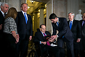 Former Senator Bob Dole is presented with the congressional Gold Medal, by U.S. House Speaker Paul Ryan, a Republican from Wisconsin, at the U.S. Capitol, in Washington D.C., U.S., on Wednesday, Jan. 17, 2018. From left: U.S. Vice President Mike Pence, U.S. President Donald Trump, Dole, Ryan, Senate Majority Leader Mitch McConnell, a Republican from Kentucky, and Senate Minority Leader Chuck Schumer, a Democrat from New York. Photographer: Al Drago/Bloomberg<br /> Credit: Al Drago / Pool via CNP