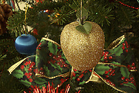 Christmas Ornaments and Bow on Spruce Tree