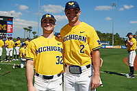Michigan Wolverines Joe Pace (32) and Jonathan Engelmann (2) before a game against Army West Point on February 17, 2018 at Tradition Field in St. Lucie, Florida.  Army defeated Michigan 4-3.  (Mike Janes/Four Seam Images)