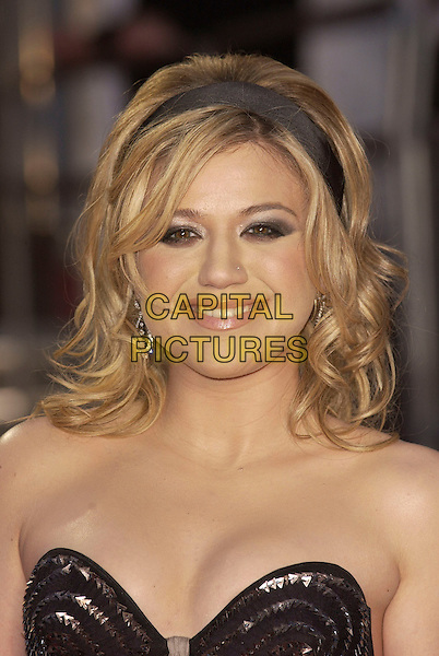 KELLY CLARKSON.The Brit Awards 2006.Earls Court, London England.15 February 2006.Ref: FIN.earl's pop music Brits headshot portrait strapless ailce band.www.capitalpictures.com.sales@capitalpictures.com.© Capital Pictures.