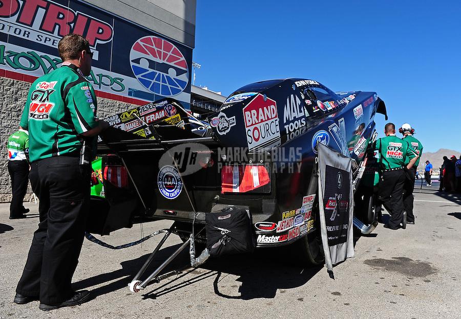 Oct. 30, 2011; Las Vegas, NV, USA: NHRA crew members for funny car driver John Force during the Big O Tires Nationals at The Strip at Las Vegas Motor Speedway. Mandatory Credit: Mark J. Rebilas-