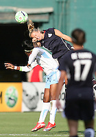 Becky Sauerbrunn #22 of the Washington Freedom wins a header from Danesha Adams #9 of the Chicago Red Stars during a WPS match at RFK stadium on June 13 2009 in Washington D.C. The game ended in a 0-0 tie.
