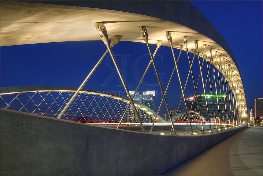 The Seventh Street Bridge in Fort Worth, Texas, opened in mid November, 2013, at a cost of ~ 25 million dollars - and opened ahead of schedule. The bridge is comprised of 12 concrete arches held together by steel beams. The Fort Worth skyline adds a nice backdrop to this newly constructed bridge.