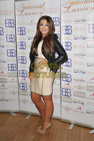 Lauren Goodger.Arrivals at the Luxury and Lifestyle Awards, Porchester Hall, London, England..March 17th 2012.full length black dress cream beige hand on hip leather .CAP/MAR.© Martin Harris/Capital Pictures.