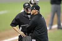 Tri-City Valleycats manager Jim Pankovits argues a call with home plate umpire Chris Tipton during game two of the NYPL Semifinals vs. the Batavia Muckdogs at Dwyer Stadium in Batavia, New York September 8, 2010.   Batavia defeated Tri-City 5-4.  Photo By Mike Janes/Four Seam Images