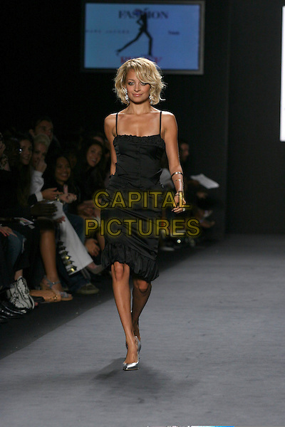 NICOLE RICHIE.Modelling at  Fashion For Relief Show at Olympus Fashion Week held at Bryant Park,.New York City, 16th September 2005.full length black strappy dress catwalk model skinny thin.Ref: IW.www.capitalpictures.com.sales@capitalpictures.com.©Capital Pictures