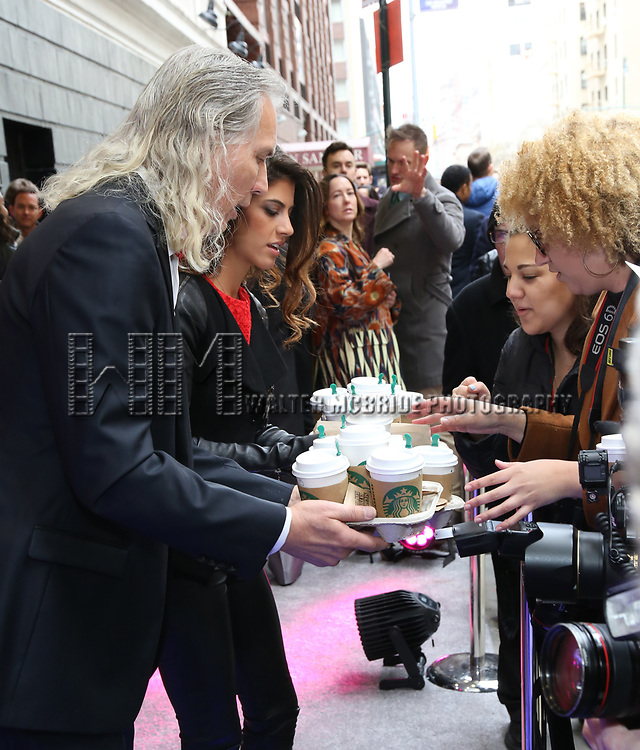 "Corey Brunish and Jessica Rose Brunish bring coffee to the press photographers at the Broadway Opening Night Arrivals for ""Angels In America"" - Part One and Part Two at the Neil Simon Theatre on March 25, 2018 in New York City."