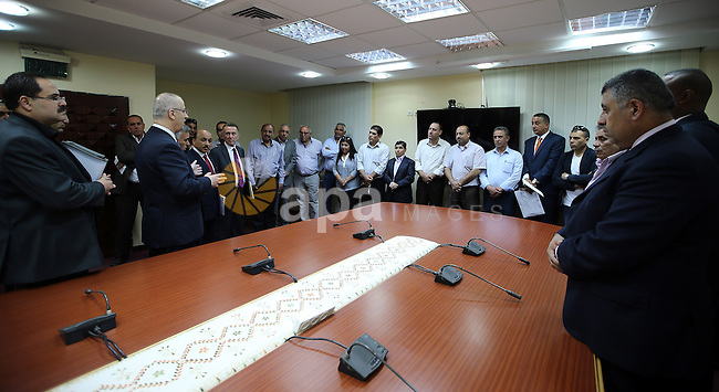 Palestinian Prime minister Rami Hamdallah attends the Signing an agreement between the Ministries of Local Government and Education and Islamic Bank, in the West bank city of Ramallah on May 31, 2016. Photo by Prime Minister Office